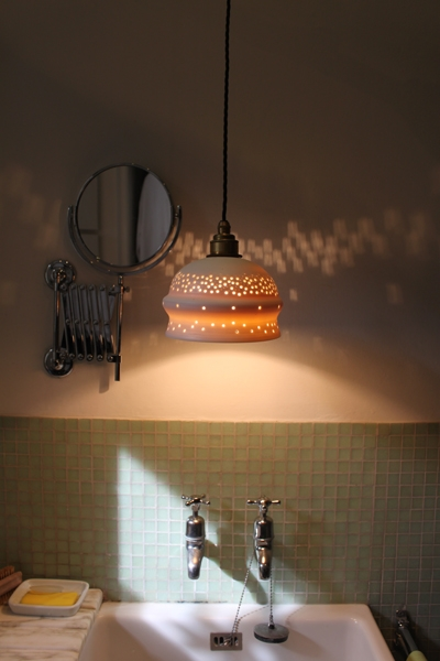 The contrasting cloth flex on Jacqui's porcelain lamp perfectly complements this functional space.